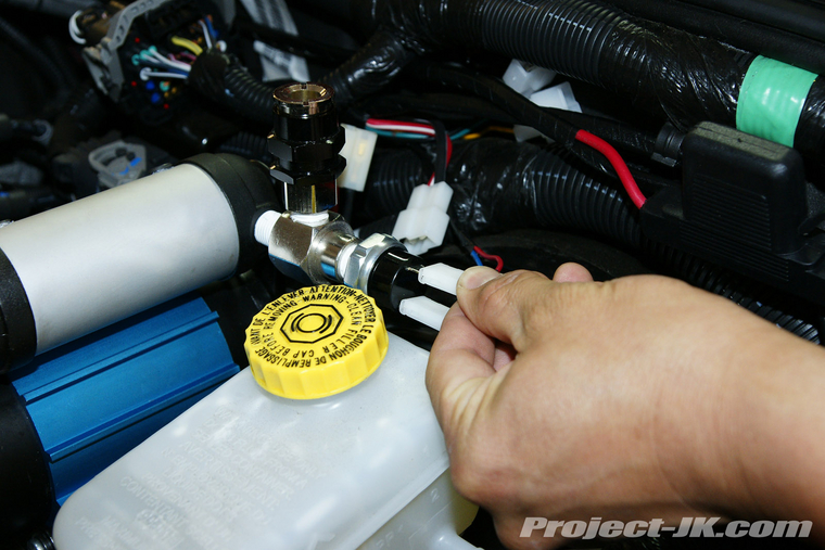 arb high output on board air compressor under the hood jk lay the long wiring harness that comes the arb air compressor along the firewall so that it extends from the battery to the brake booster