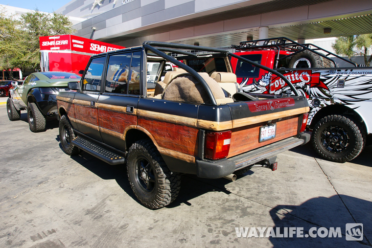 Okay, it's not a Jeep but holy cow, I thought you might enjoy seeing an old  Range Rover with wood paneling that would put a Wagoneer to shame. - 2013 SEMA Range Rover With Wood Sides